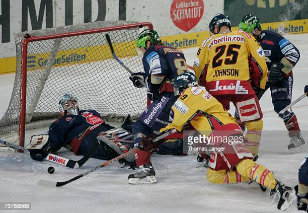 Jean-Francois Labbe of Nuremberg saves against Rob Collins of Dusseldorf during the DEL Play Off semi final match between Sinupret Ice Tigers and DEG...