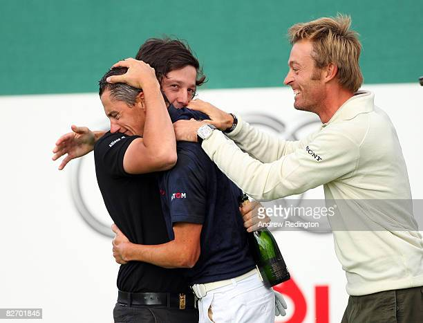 JeanFrancois Lucquin of France is congratulated by fellow French Tour golfers Raphael Jacquelin and Michael LorenzoVera after holing a putt at the...