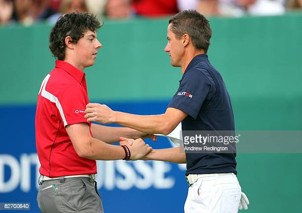 JeanFrancois Lucquin of France shakes hands with Rory McIlroy of Northern Ireland after holing a putt at the second playoff hole to win the Omega...