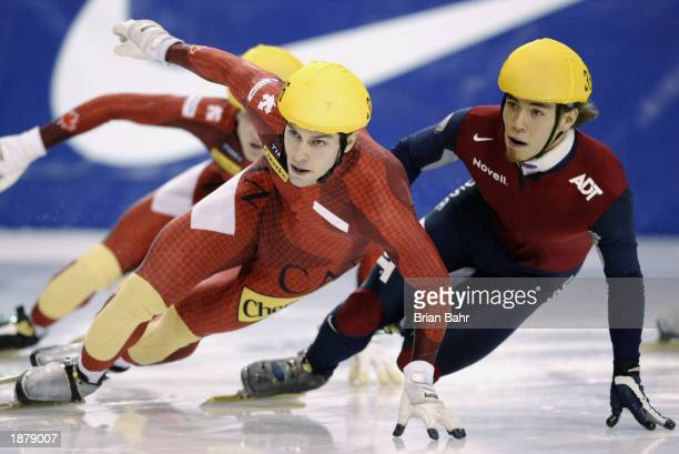JeanFrancois Monette of Canada keeps Apolo Anton Ohno of the USA at bay during the men's 500 meter finals of the ISU Short Track Speedskating World...