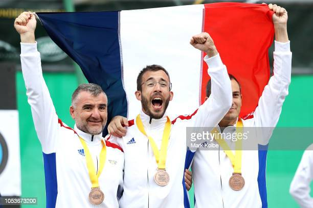 JeanFrancois Montoya Luc Berton and Cyril Camille Ludovuc Auxant of France celebrate bronze in the Team Novice Recurve celebrate bronze in the Team...