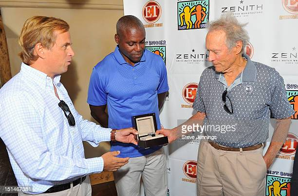 JeanFrederic Dufour presents Clint Eastwood with a Zenith watch as Carl Lewis looks on at the Entertainment Tonight Best Buddies Golf Challenge...