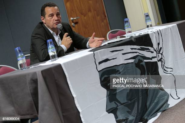 JeanFrederic Poisson candidate for the rightwing Les Republicains party primaries ahead of the 2017 presidential election speaks during a meeting in...
