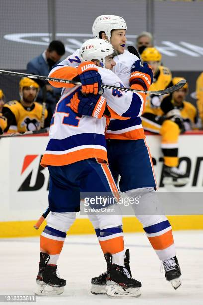 Jean-Gabriel Pageau celebrates his goal during the third period with Matt Martin of the New York Islanders in Game One of the First Round of the 2021...