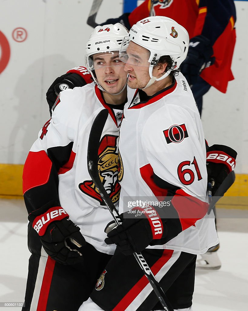 Jean-Gabriel Pageau #44 is congratulated by Mark Stone #61 of the Ottawa Senators after he scored a short handed open net goal against the Florida Panthers at the BB&T Center on December 8, 2015 in Sunrise, Florida. The Senators defeated the anthers 4-2.