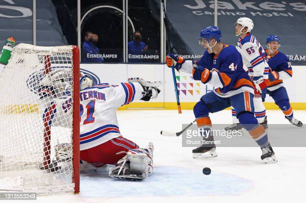 Jean-Gabriel Pageau of the New York Islanders celebrates a second period goal by Anthony Beauvillier against Igor Shesterkin of the New York Rangers...