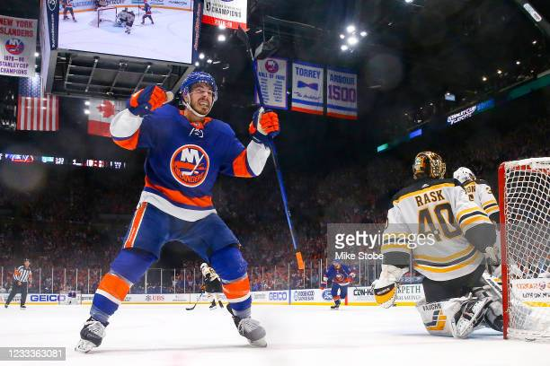 Jean-Gabriel Pageau of the New York Islanders celebrates after his teammate Kyle Palmieri scored a goal past Tuukka Rask of the Boston Bruins during...