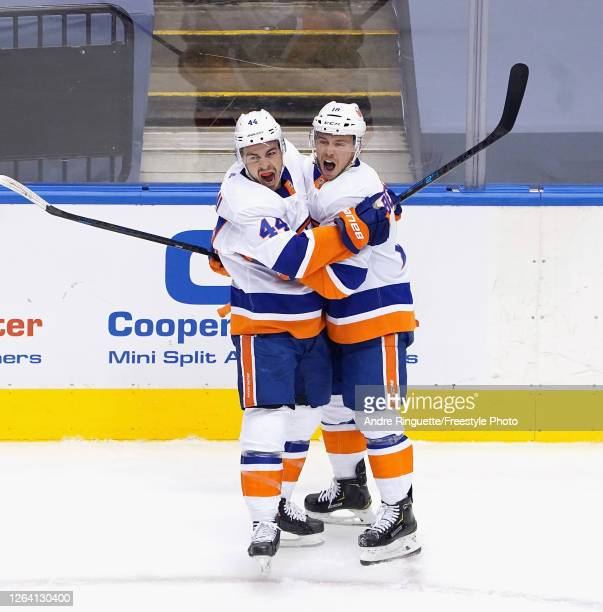 JeanGabriel Pageau of the New York Islanders celebrates his goal at 1626 of the first period against the Florida Panthers and is joined by Anthony...