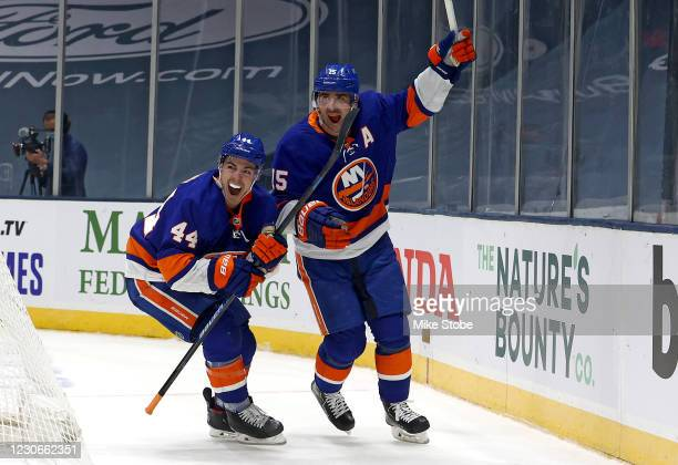 Jean-Gabriel Pageau of the New York Islanders celebrates with Cal Clutterbuck after scoring a goal against the Boston Bruins during the third period...