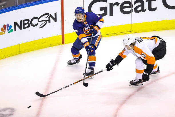 Jean-Gabriel Pageau of the New York Islanders is defended by Travis Sanheim of the Philadelphia Flyers during the first period in Game Three of the...