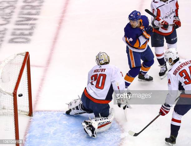 JeanGabriel Pageau of the New York Islanders scores a goal at 350 past Braden Holtby of the Washington Capitals during the first period in Game Four...