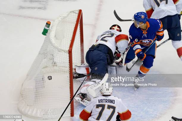 JeanGabriel Pageau of the New York Islanders scores a goal on Sergei Bobrovsky of the Florida Panthers during the first period in Game One of the...