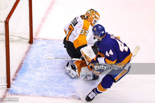 Jean-Gabriel Pageau of the New York Islanders scores a goal past Brian Elliott of the Philadelphia Flyers during the third period in Game Four of the...