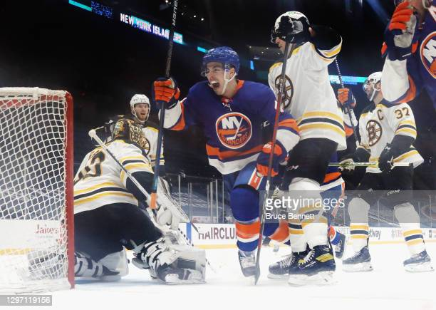 Jean-Gabriel Pageau of the New York Islanders scores at 15:51 of the third period against Tuukka Rask of the Boston Bruins at the Nassau Coliseum on...