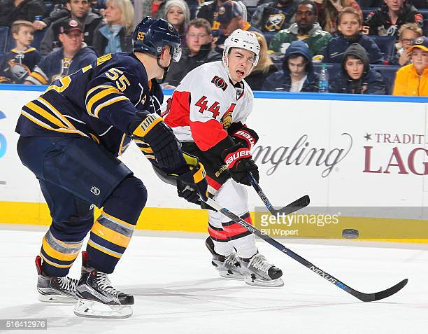 JeanGabriel Pageau of the Ottawa Senators backhands a shot while being defended by Rasmus Ristolinen of the Buffalo Sabres during an NHL game on...