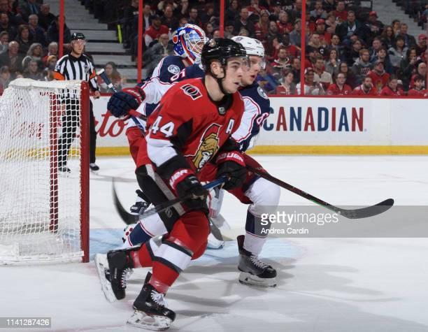 JeanGabriel Pageau of the Ottawa Senators battles for position against Markus Nutivaara of the Columbus Blue Jackets at Canadian Tire Centre on April...