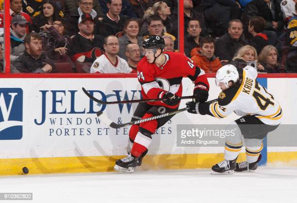 JeanGabriel Pageau of the Ottawa Senators battles for puck possession against Torey Krug of the Boston Bruins at Canadian Tire Centre on January 25...