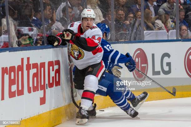 JeanGabriel Pageau of the Ottawa Senators battles for the puck against Patrick Marleau of the Toronto Maple Leafs during the second period at the Air...