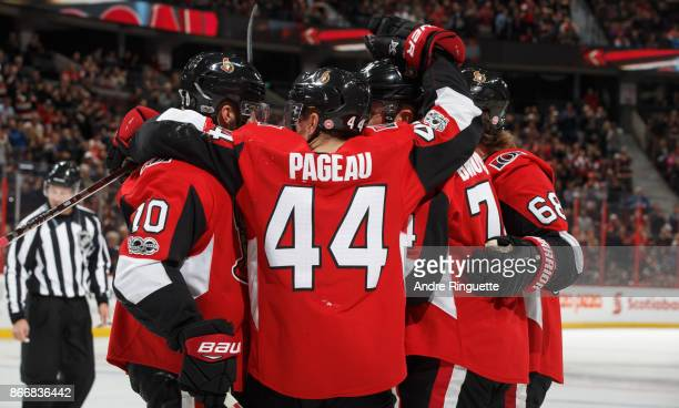 JeanGabriel Pageau of the Ottawa Senators celebrates a first period goal by Mark Borowiecki against the Philadelphia Flyers with teammates Tom Pyatt...