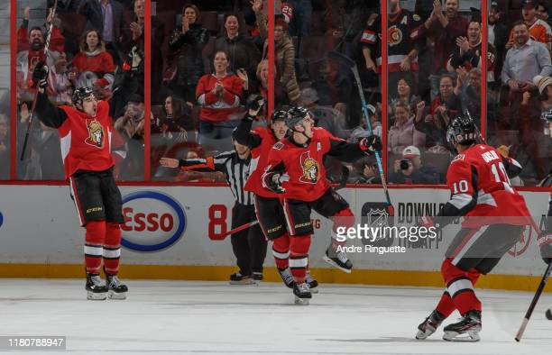 Jean-Gabriel Pageau of the Ottawa Senators celebrates his game-winning overtime goal against the Los Angeles Kings with teammates Nick Paul and...