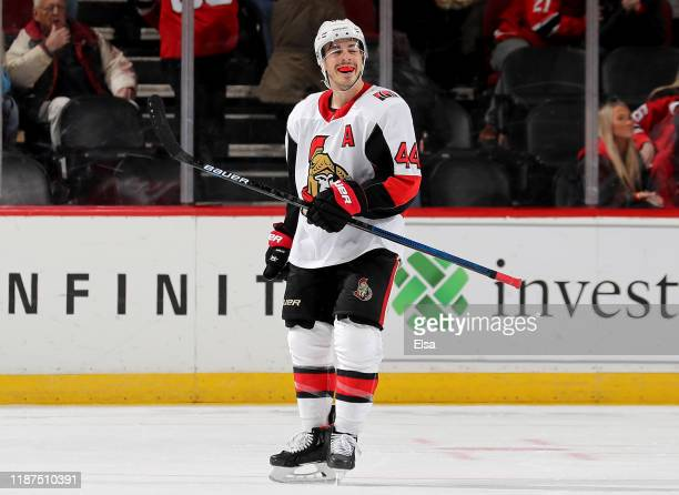 Jean-Gabriel Pageau of the Ottawa Senators celebrates his hat trick in the third period after he scored an empty net goal against the New Jersey...