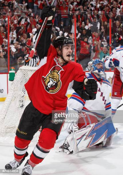 JeanGabriel Pageau of the Ottawa Senators celebrates his last minute gametying hattrick goal against Henrik Lundqvist of the New York Rangers in Game...