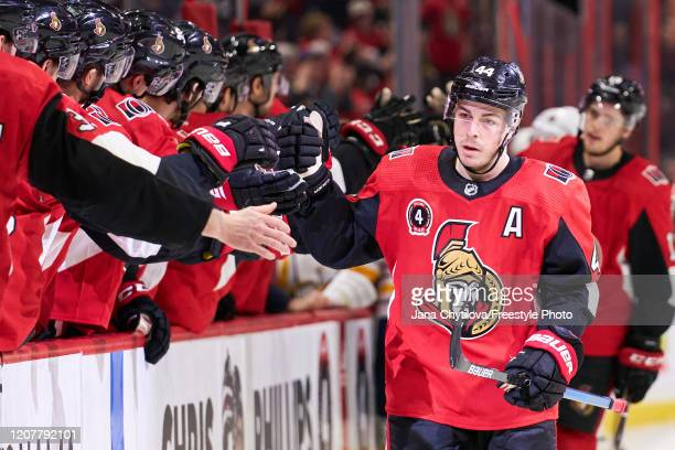 JeanGabriel Pageau of the Ottawa Senators celebrates his third period powerplay goal against the Buffalo Sabres with teammates on the bench at...