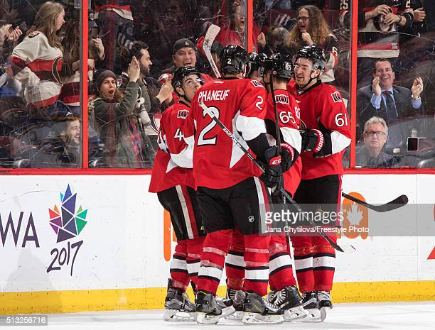 JeanGabriel Pageau of the Ottawa Senators celebrates his third period goal against the St Louis Blues with team mates Dion Phaneuf Erik Karlsson and...