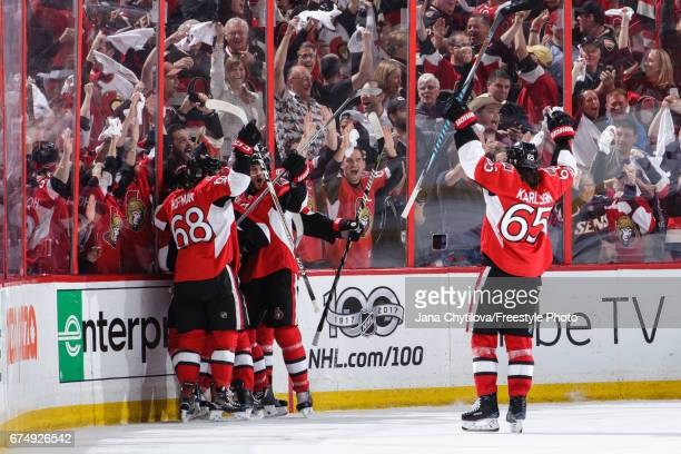 JeanGabriel Pageau of the Ottawa Senators celebrates his third period game tying goal and hat trick against the New York Rangers with teammates Erik...