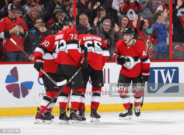 JeanGabriel Pageau of the Ottawa Senators celebrates his third period goal against the Tampa Bay Lightning with teammates Tom Pyatt Thomas Chabot and...