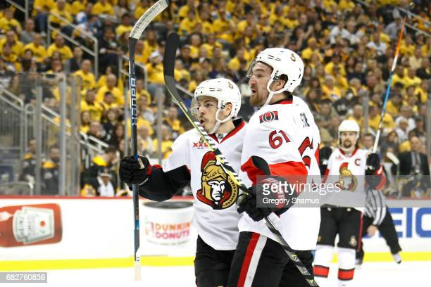 JeanGabriel Pageau of the Ottawa Senators celebrates with his teammate Mark Stone after scoring a goal against MarcAndre Fleury of the Pittsburgh...