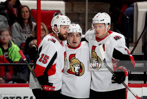 JeanGabriel Pageau of the Ottawa Senators celebrates with teammates Zack Smith and Dion Phaneuf after scoring a goal during an NHL game against the...