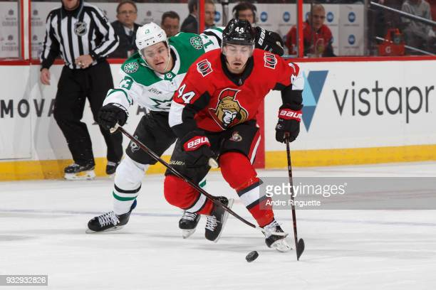 JeanGabriel Pageau of the Ottawa Senators controls the puck as Mattias Janmark of the Dallas Stars reaches with his stick to defend against at...