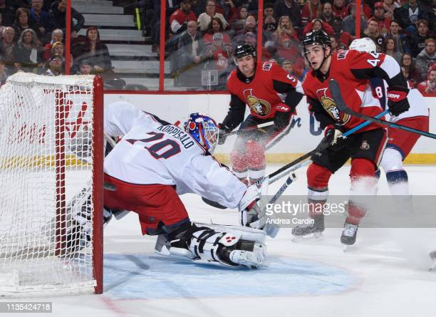 JeanGabriel Pageau of the Ottawa Senators creates traffic in front of Joonas Korpisalo of the Columbus Blue Jackets as the puck sails past the net at...
