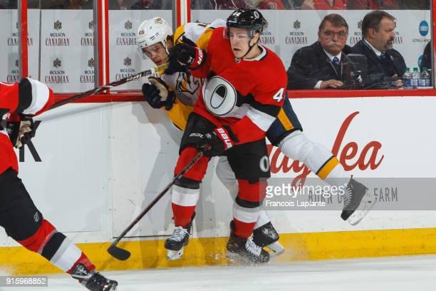 JeanGabriel Pageau of the Ottawa Senators finishes his checks against Pontus Aberg of the Nashville Predators at Canadian Tire Centre on February 9...