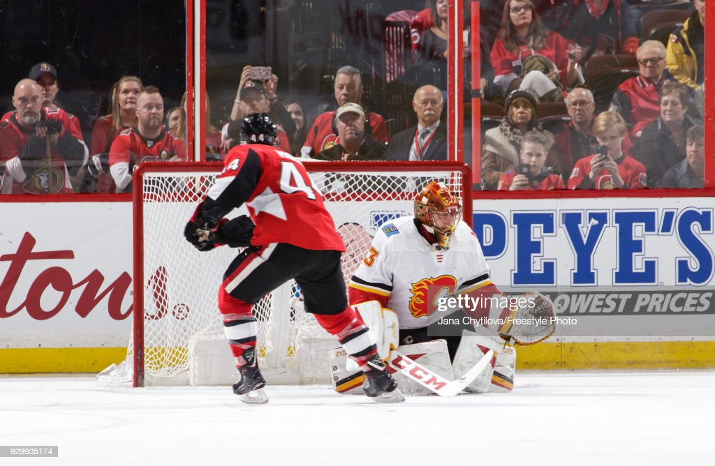 Jean-Gabriel Pageau #44 of the Ottawa Senators gets the puck past David Rittich #33 of the Calgary Flames on a penalty shot in the third period at Canadian Tire Centre on March 9, 2018 in Ottawa, Ontario, Canada.