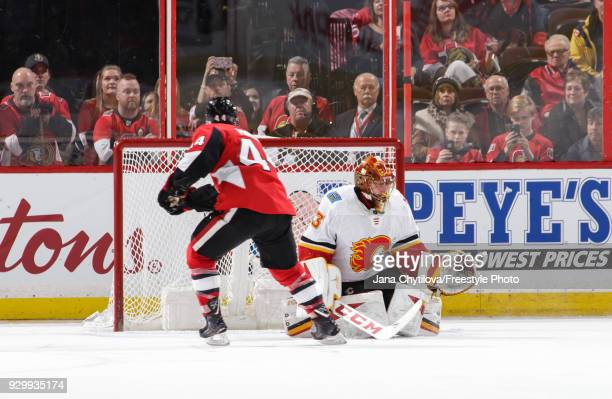 JeanGabriel Pageau of the Ottawa Senators gets the puck past David Rittich of the Calgary Flames on a penalty shot in the third period at Canadian...