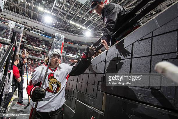 JeanGabriel Pageau of the Ottawa Senators highfives a fan as he leaves warmup prior to a game against the Detroit Red Wings at Canadian Tire Centre...