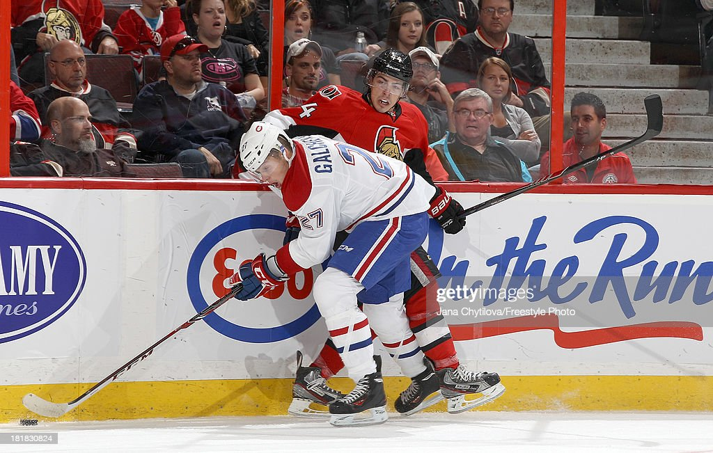 Jean-Gabriel Pageau #44 of the Ottawa Senators is checked by a puck carrying Alex Galchenyuk #27 of the Montreal Canadiens during an NHL pre-season game at Canadian Tire Centre on September 25, 2013 in Ottawa, Ontario, Canada.