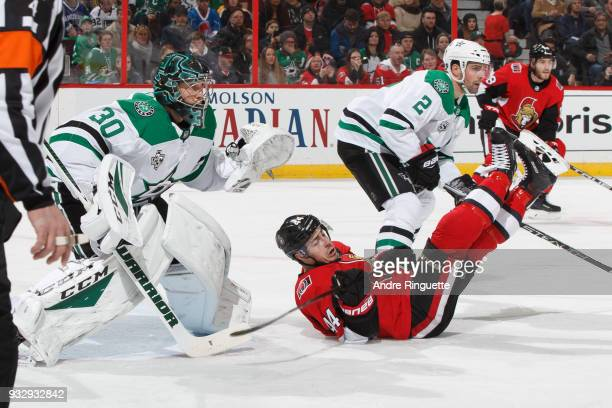 JeanGabriel Pageau of the Ottawa Senators is dumped to the ice by Dan Hamhuis of the Dallas Stars in front of Ben Bishop at Canadian Tire Centre on...