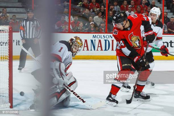 JeanGabriel Pageau of the Ottawa Senators looks on as the puck goes behind Keith Kinkaid of the New Jersey Devils at Canadian Tire Centre on February...