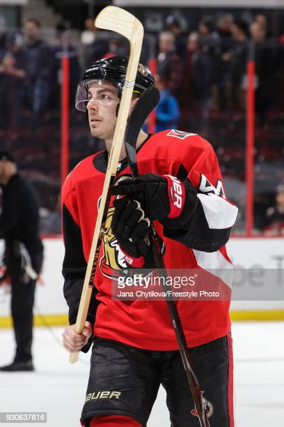 JeanGabriel Pageau of the Ottawa Senators looks to give away a stick after being named the third star following a game against the Calgary Flames at...