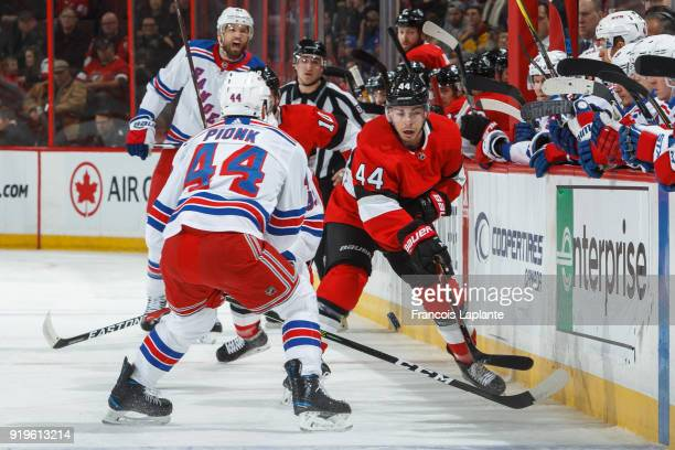 JeanGabriel Pageau of the Ottawa Senators passes the puck against Neal Pionk of New York Rangers at Canadian Tire Centre on February 18 2018 in...
