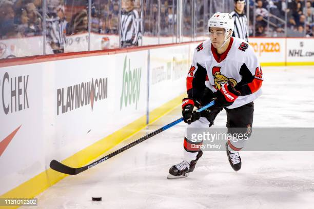 JeanGabriel Pageau of the Ottawa Senators plays the puck along the boards during third period action against the Winnipeg Jets at the Bell MTS Place...