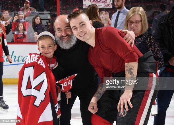 JeanGabriel Pageau of the Ottawa Senators poses for a picture with fans after giving away his jersey on fan appreciation night after the last home...