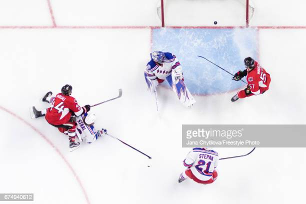 JeanGabriel Pageau of the Ottawa Senators scores the overtime goal and his fourth goal of the game as Henrik Lundqvist of the New York Rangers...