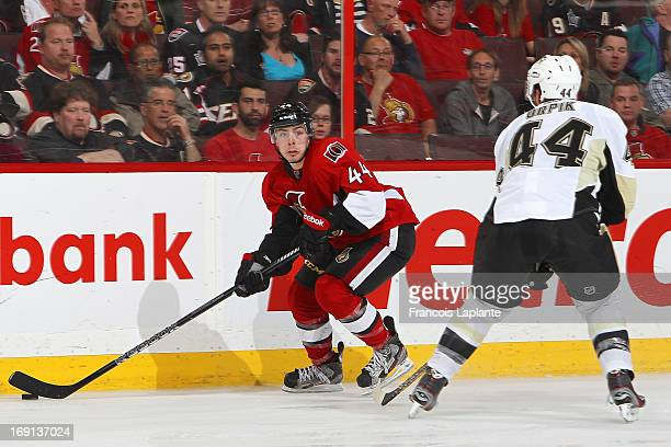 JeanGabriel Pageau of the Ottawa Senators skates with the puck against Brooks Orpik of the Pittsburgh Penguins in Game Three of the Eastern...
