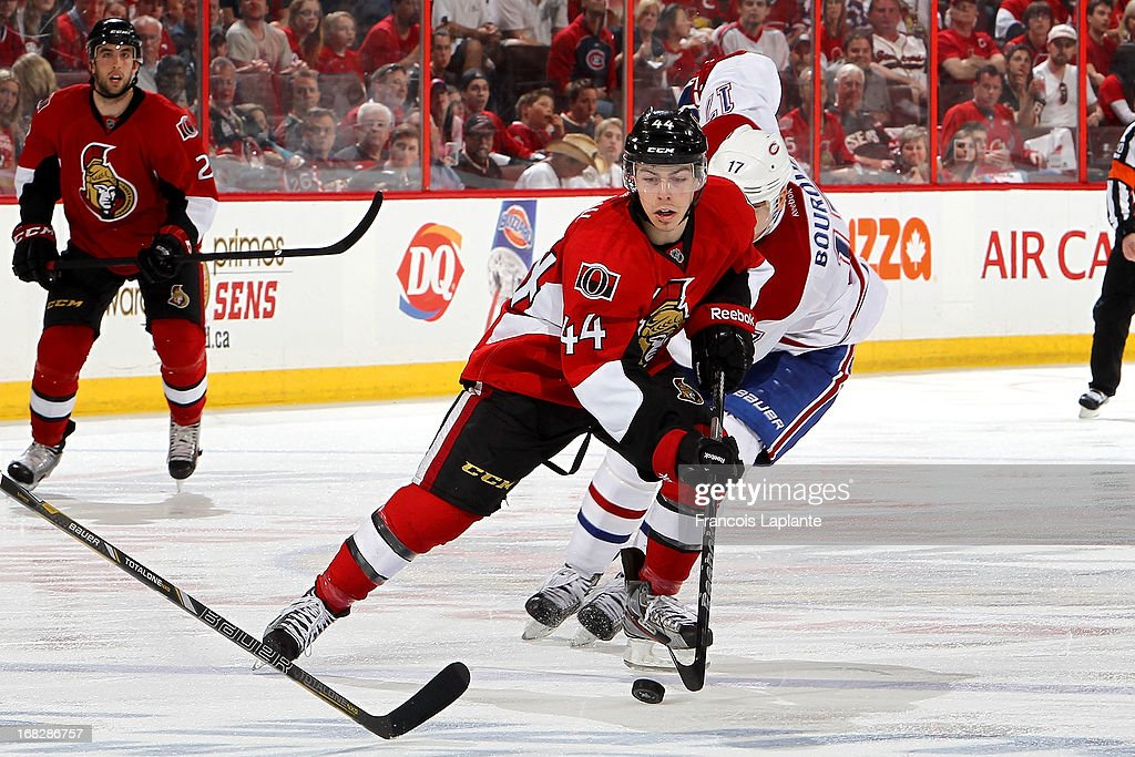 Jean-Gabriel Pageau #44 of the Ottawa Senators skates with the puck against Rene Bourque #17 the Montreal Canadiens in Game Four of the Eastern Conference Quarterfinals during the 2013 NHL Stanley Cup Playoffs at Scotiabank Place on May 7, 2013 in Ottawa, Ontario, Canada.
