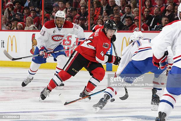 JeanGabriel Pageau of the Ottawa Senators skates with the puck against Tom Gilbert of the Montreal Canadiens in Game Four of the Eastern Conference...