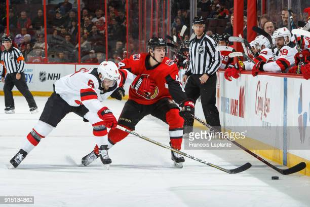 JeanGabriel Pageau of the Ottawa Senators stickhandles the puck with one hand against Will Butcher of the New Jersey Devils at Canadian Tire Centre...